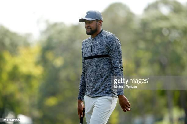 Tony Finau reacts after a putt on the second green during the first round of the Valspar Championship at Innisbrook Resort Copperhead Course on March...