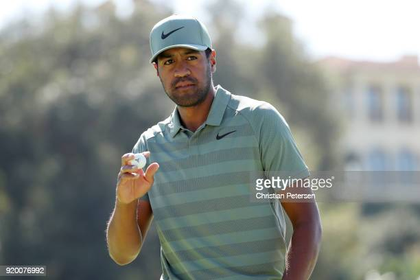 Tony Finau reacts after making par on the eighth green during the final round of the Genesis Open at Riviera Country Club on February 18 2018 in...