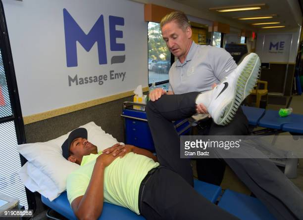 Tony Finau receives a treatment by Massage Envy Physical Therapist Jeff Hendra during the Genesis Open at Riviera Country Club on February 14 2018 in...