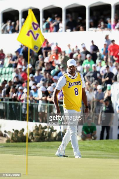Tony Finau walks the 16th green wearing a jersey of former NBA player Kobe Bryant during the final round of the Waste Management Open at TPC...