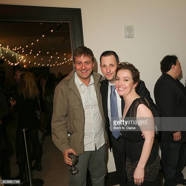Tony Frenzel and director Domenica CameronScorsese pose with a guest during the Almost Paris premiere after party on April 24 2016 in New York City