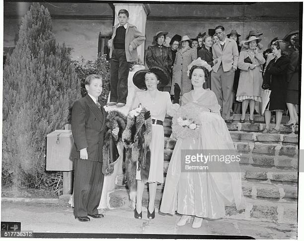 Tony Furness his mother Lady Thelma Furness and Mrs Gloria Vanderbilt mother of the bride and twin sister of Lady Furness arrive at the historic...