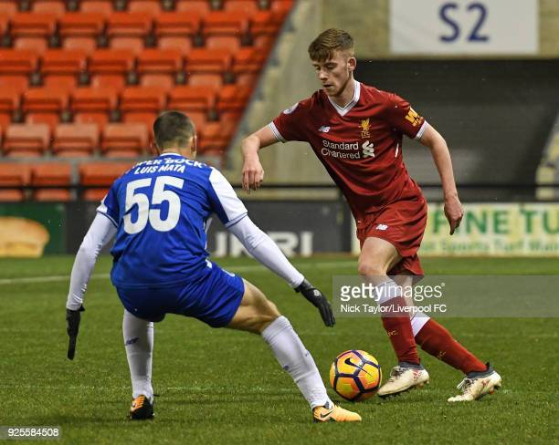 Tony Gallacher of Liverpool and Luis Mata of Porto in action during the Liverpool v Porto Premier League International Cup game at Leigh Sports...