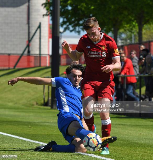 Tony Gallacher of Liverpool and Nathan Minhas of Panjab FA in action at The Kirkby Academy on May 14 2018 in Kirkby England