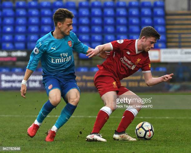 Tony Gallacher of Liverpool and Vlad Dragomir of Arsenal in action during the Liverpool U23 v Arsenal U23 game at Prenton Park on April 6 2018 in...