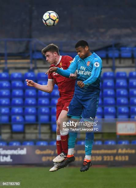 Tony Gallacher of Liverpool and Vontae DaleyCampbell in action during the Liverpool U23 v Arsenal U23 game at Prenton Park on April 6 2018 in...