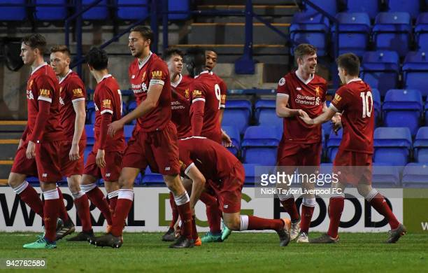 Tony Gallacher of Liverpool celebrates his goal with Adam Lewis and other team mates during the Liverpool U23 v Arsenal U23 game at Prenton Park on...