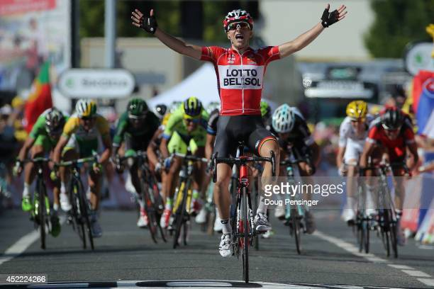 Tony Gallopin of France and Lotto Belisol celebrates as his solo breakaway eludes the peloton in the final meters to win the eleventh stage of the...