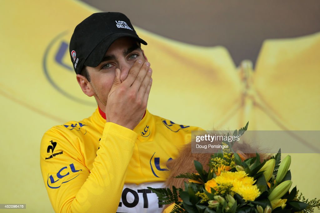 Tony Gallopin of France and Lotto Belisol takes the podium after claiming the overall race leader's jersey in stage nine of the 2014 Le Tour de France from Gerardmer to Mulhouse on July 13, 2014 in Mulhouse, France.