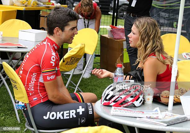 Tony Gallopin of France and LottoBelisol and his girlfriend professional cyclist Marion Rousse relax prior to the start of stage eighteen of the 2014...