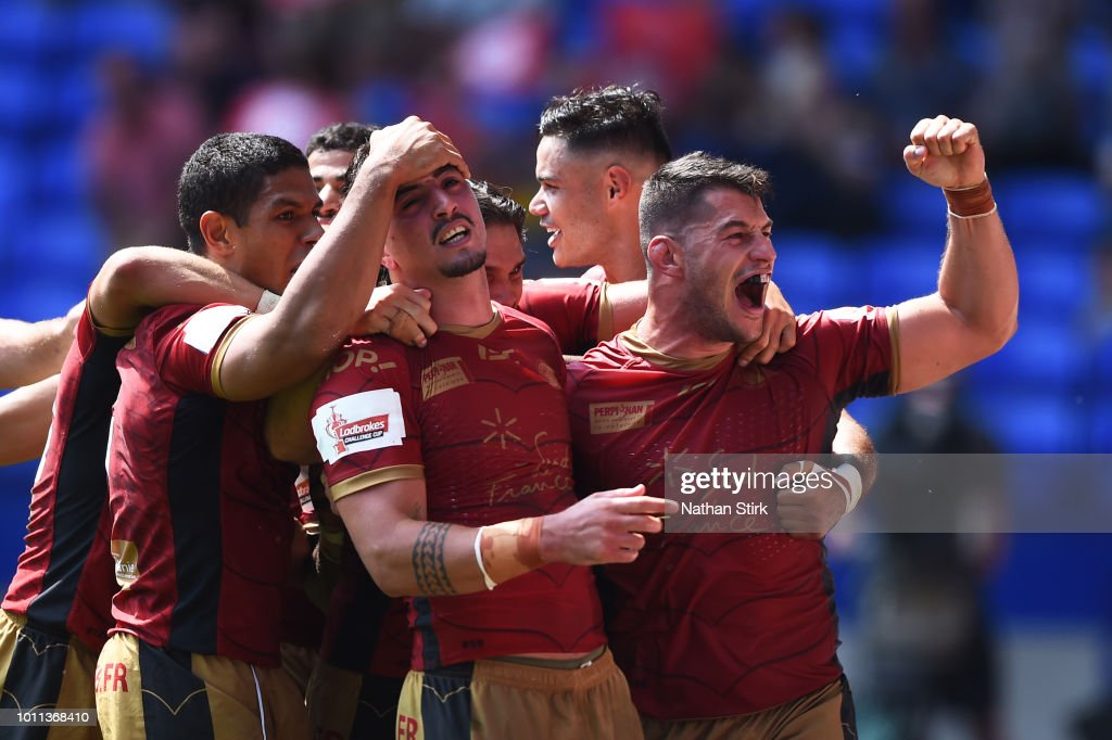 Tony Gigot of Catalans Dragons celebrates (C) with his team mates after scoring a try during the Ladbrokes Challenge Cup Semi Final match between St Helens and Catalans Dragons at Macron Stadium on August 5, 2018 in Bolton, England.