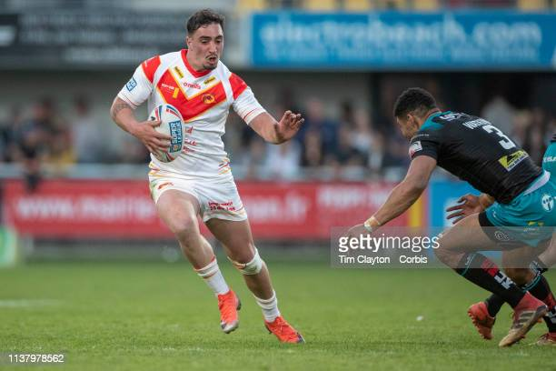 March 23: Tony Gigot of Catalans Dragons defended by Kallum Watkins of Leeds Rhinos during the Catalans Dragons V Leeds Rhinos, Betfred Super League...