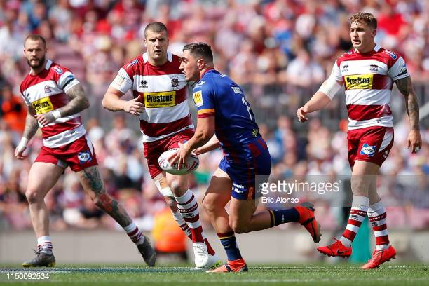 Tony Gigot of Catalans Dragons releases a pass during the Betfred Super League match at Camp Nou on May 18 2019 in Barcelona Spain