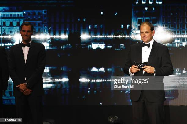 Tony Godsick , agent of Roger Federer and President and CEO of TEAM8 and Chairman of the Laver Cup speaks on stage as Roger Federer looks on during...