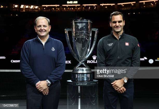Tony Godsick Laver Cup Chairman and Roger Federer pose for a photograph with the Laver Cup Trophy after taking part in a live TV interview on CNBC at...