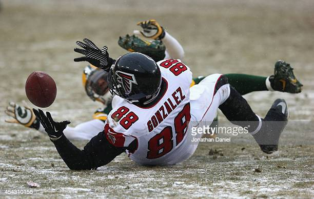 Tony Gonzalez of the Atlanta Falcons can't hold on to the ball on a 4th down play against the Green Bay Packers at Lambeau Field on December 8, 2013...