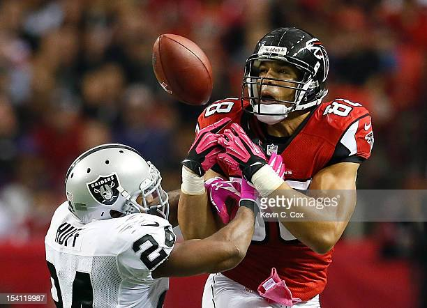 Tony Gonzalez of the Atlanta Falcons fails to pull in this reception against Michael Huff of the Oakland Raiders at Georgia Dome on October 14 2012...
