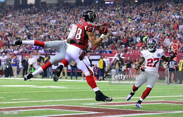 Tony Gonzalez of the Atlanta Falcons makes a catch for a first quarter touchdown against the New York Giants at the Georgia Dome on December 16, 2012...