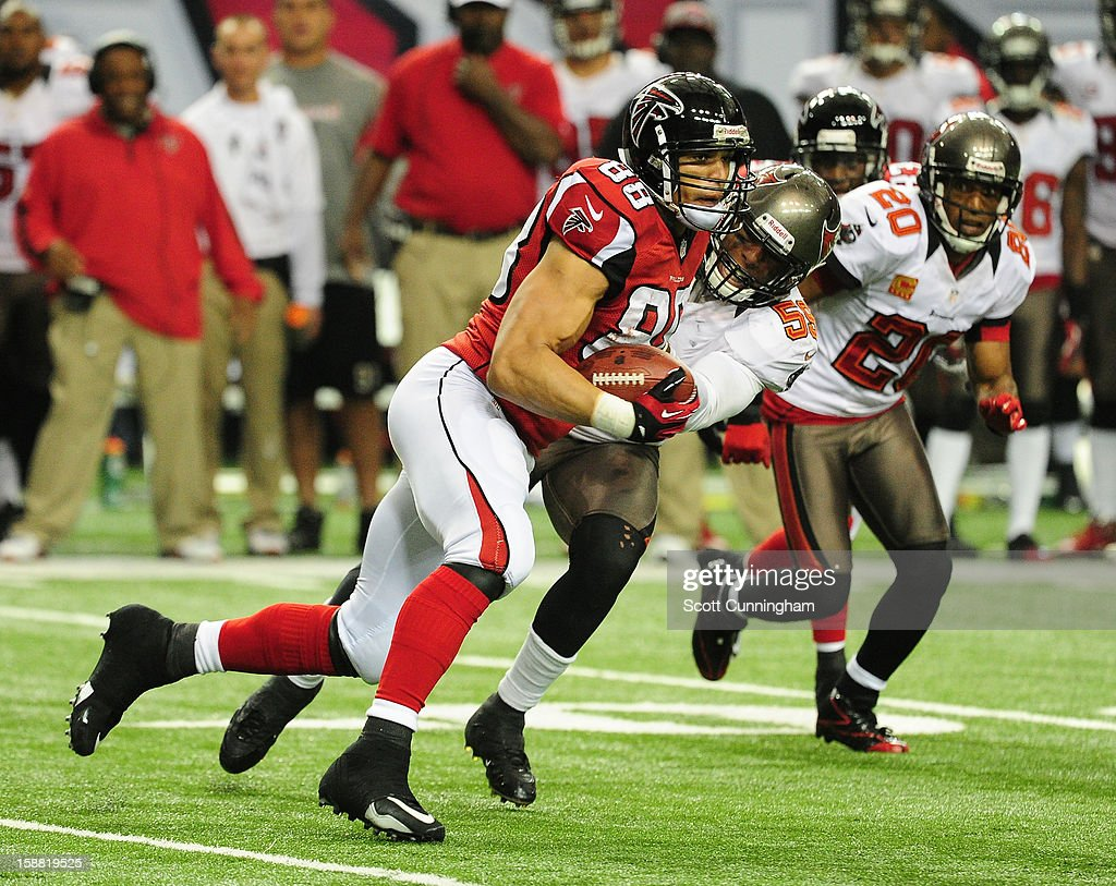 Tony Gonzalez #88 of the Atlanta Falcons runs with a catch against the Tampa Bay Buccaneers at the Georgia Dome on December 30, 2012 in Atlanta, Georgia