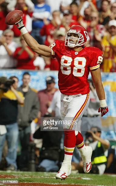 Tony Gonzalez of the Kansas City Chiefs holds out the ball in celebration in the end zone during the game against the Indianapolis Colts at Arrowhead...