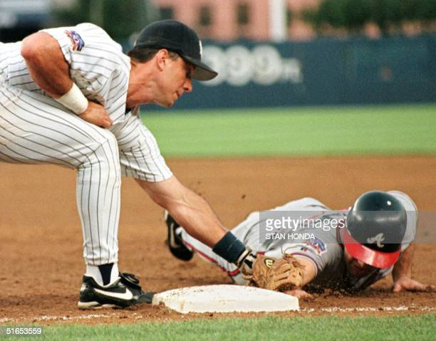 Tony Graffanino of the Atlanta Braves is picked off first base as New York Yankees first baseman Tino Martinez makes the tag in third inning of...