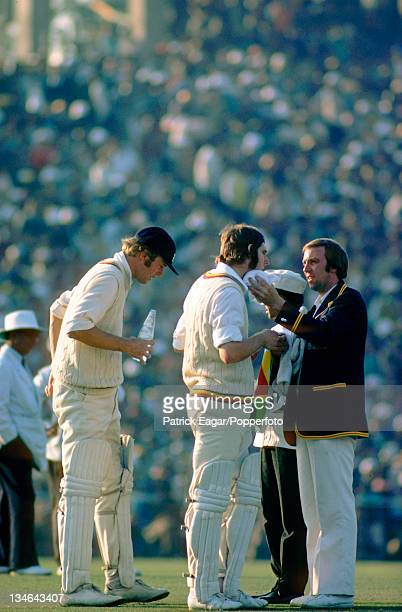 Tony Greig and Chris Old at a drinks break Geoff Cope is doing 12th man duties India v England 2nd Test Calcutta Jan 197677
