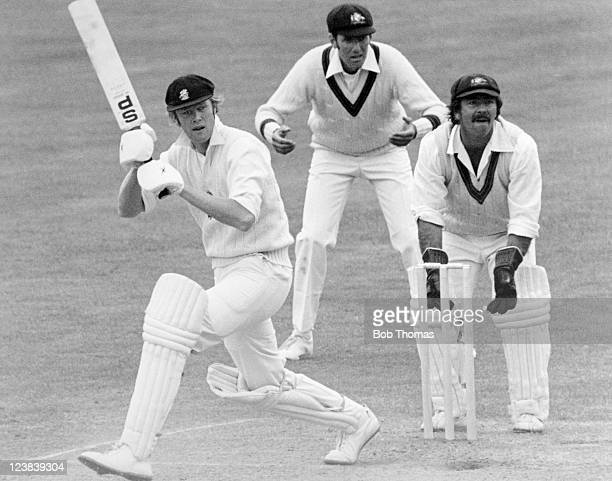 Tony Greig of England batting during his innings of 91 runs watched by Rick McCosker and wicketkeeper Rod Marsh of Australia during the 1st Test...