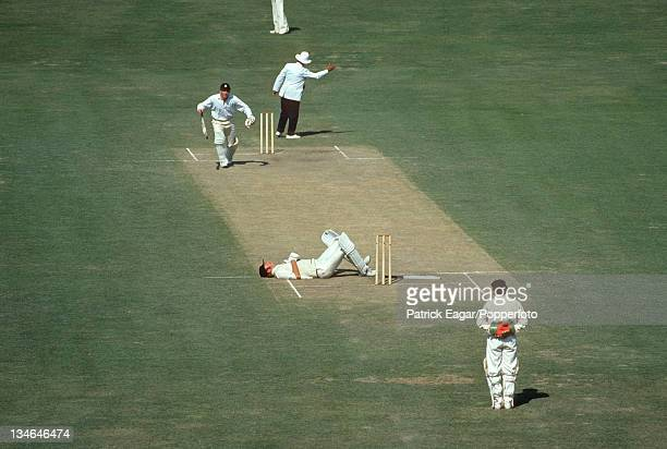Tony Greig plays to the crowd after a fire cracker had been thrown. He made 103, the other batsman is Roger Tolchard ., India v England, 2nd Test,...