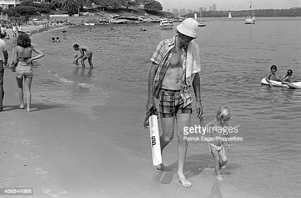 Tony Greig with his daughter Samantha on the beach at Camp Cove Sydney 1976