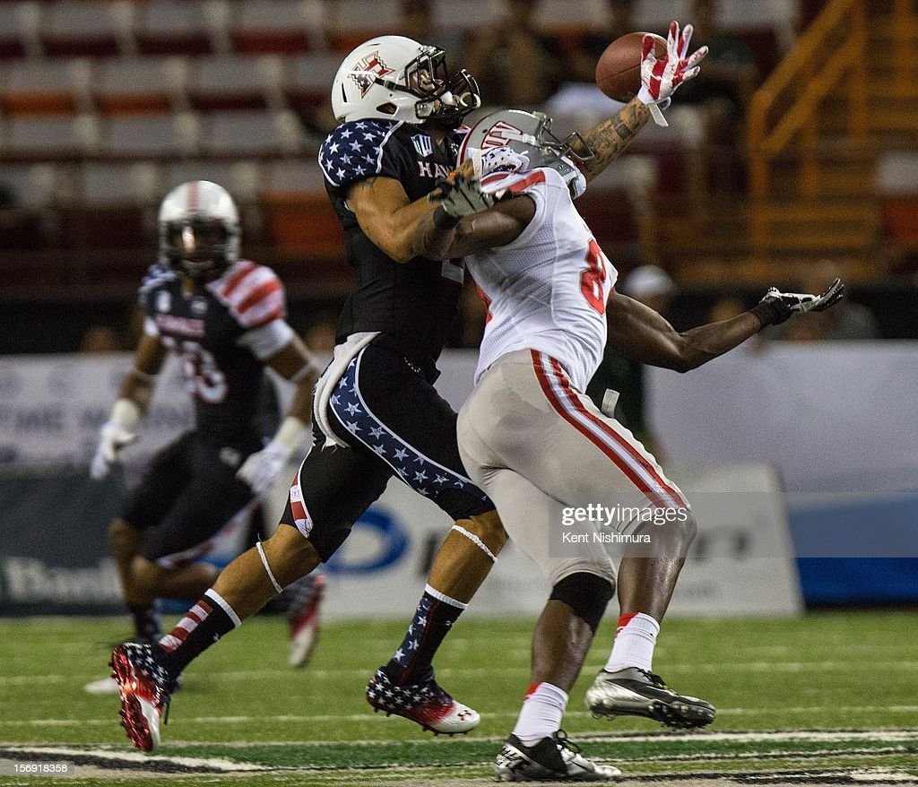 Tony Grimes #2 of the Hawaii Warriors breaks up a pass intended for Devante Davis #81 of the UNLV Rebels during a NCAA college football game between the UNLV Rebels and the Hawaii Warriors on November 24, 2012 at Aloha Stadium in Honolulu, Hawaii.