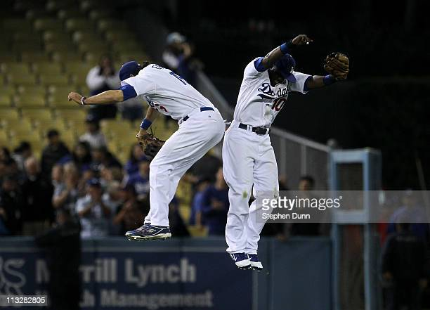 Tony Gwynn Jr #10 and Andre Ethier of the Los Angeles Dodgers celebrate after Gwynn's game saving diving catch in left field to end the game against...