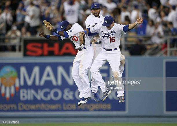 Tony Gwynn Matt Kemp and Andre Ethier of the Los Angeles Dodgers celebrate their 21 win over the San Francisco Giants on Opening Day at Dodger...