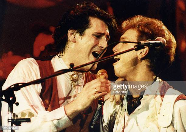 Tony Hadley and Gary Kemp of Spandau Ballet perform on stage on the 'Parade' tour at Wembley Arena on December 8th 1984 in London England