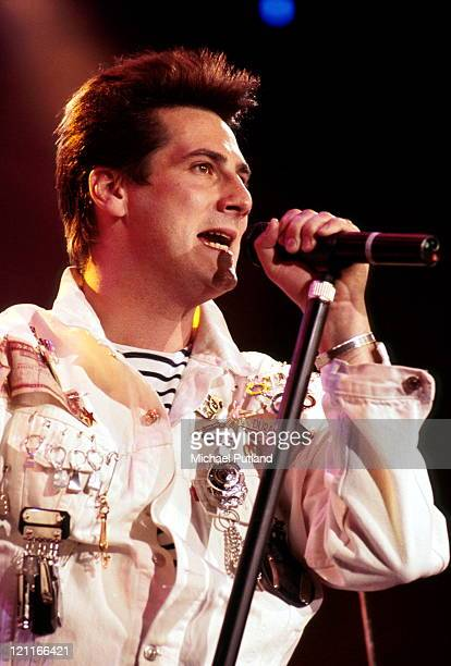 Tony Hadley of Spandau Ballet perform on stage, London, 1987.