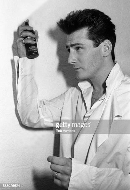 Tony Hadley of Spandau Ballet puts on hairspray backstage Ahoy Rotterdam Netherlands 28th February 1987
