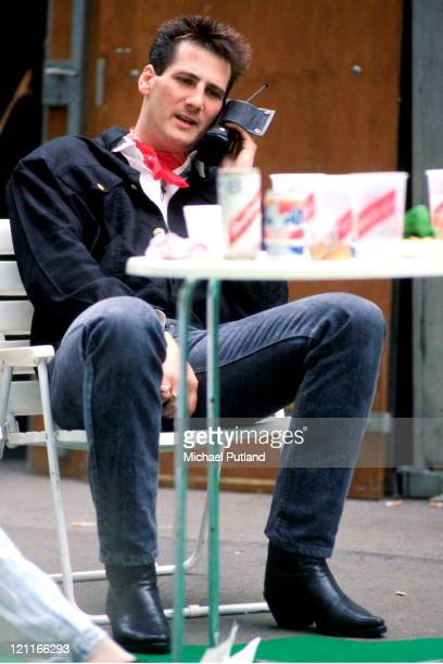Tony Hadley of Spandau Ballet uses an early mobile phone during the soundcheck of the Nelson Mandela 70th Birthday Tribute Concert Wembley Stadium...