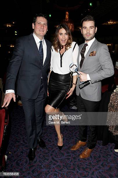 Tony Hadley poses with Lisa Snowdon and Dave Berry winners of the Radio/Digital Radio Programme award at the TRIC Television and Radio Industries...