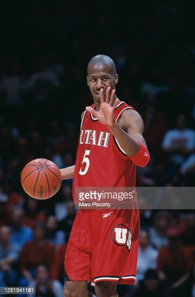Tony Harvey, Guard for the University of Utah Utes makes hand signals to his team mates during the NCAA Western Athletic Conference college...