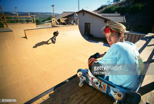 Tony Hawk 18 years old sits on one of his skateboard ramps in his back yard which he built for his friends and himself In 1986 he was making in...