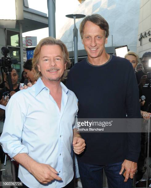 Tony Hawk and David Spade arrive at Father Of The Year LA Special Screening at ArcLight Hollywood on July 19 2018 in Hollywood California
