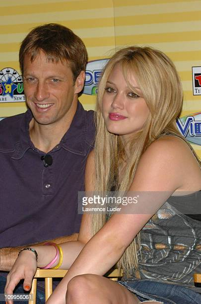 Tony Hawk and Hilary Duff during Hilary Duff and Tony Hawk Introduce Hasbro's Videonow Color Personal Player at Toys R Us in New York City New York...