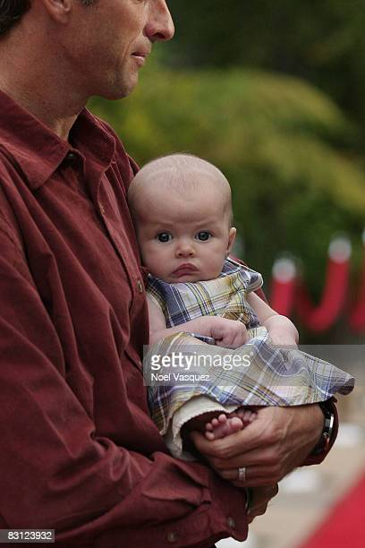Tony Hawk and his baby daughter Kadence Clover Hawk attend the Ante Up For Autism benefit event at the St Regis Monarch Beach Resort on October 3...