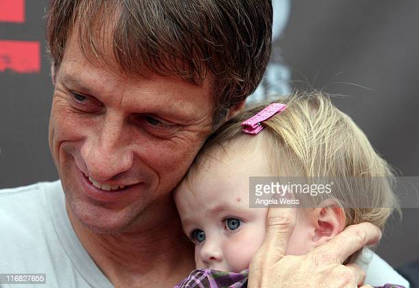 Tony Hawk and his daughter Kadence Clover Hawk attend the 'Tony Hawk Ride Presents Stand Up For Skateparks' benefit press conference held at the...