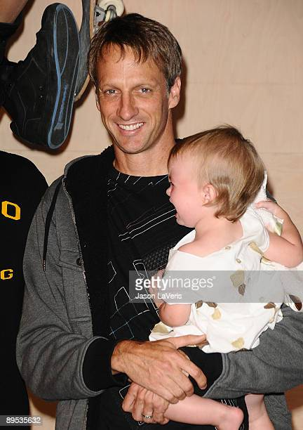 Tony Hawk and his daughter Kadence Clover Hawk attend Tony Hawk's wax figure unveiling ceremony at Madame Tussauds on July 29 2009 in Hollywood...