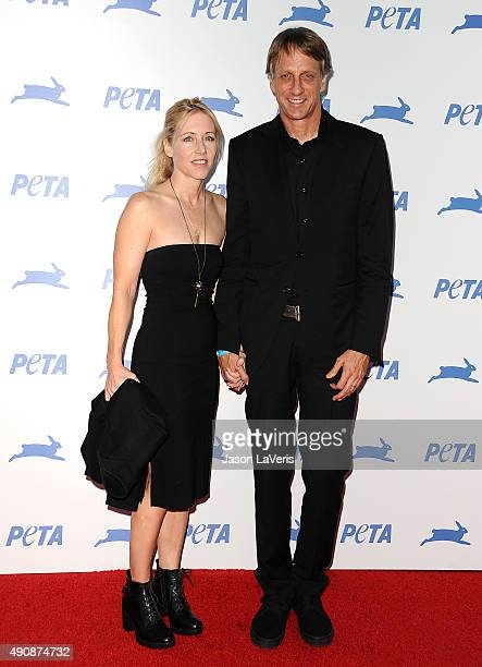 Tony Hawk and wife Catherine Goodman attend PETA's 35th anniversary party at Hollywood Palladium on September 30 2015 in Los Angeles California