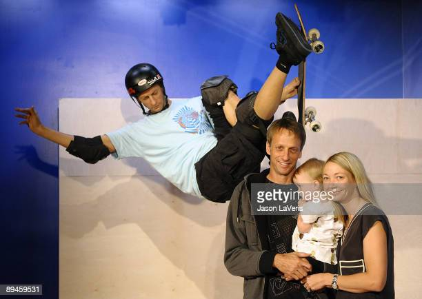 Tony Hawk Kadence Clover Hawk and Lhotse Hawk attend Tony Hawk's wax figure unveiling ceremony at Madame Tussauds on July 29 2009 in Hollywood...