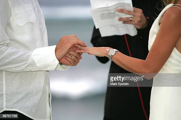 Tony Hawk places a wedding ring on his bride Lhotse Merriam's finger during their wedding ceremony January 12 2006 on the Island of Tavarua in Fiji