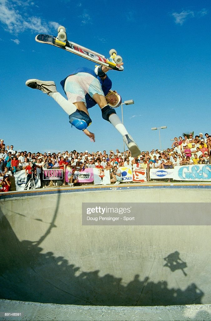 Tony Hawk performing an airwalk in an empty pool at the Del Mar skate competition in 1985.