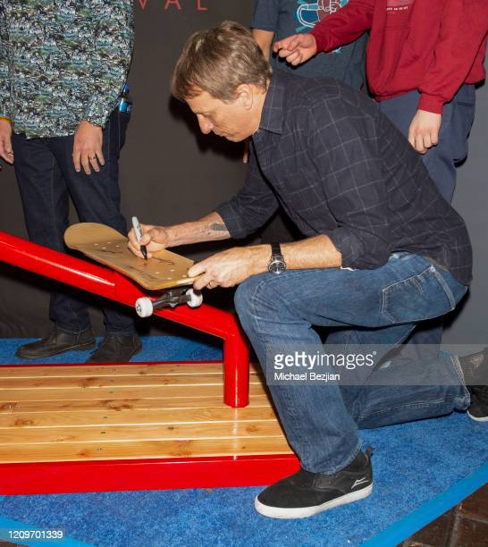 Tony Hawk signs skateboard at 3rd Annual Mammoth Film Festival Red Carpet Saturday on February 29 2020 in Mammoth Lakes California
