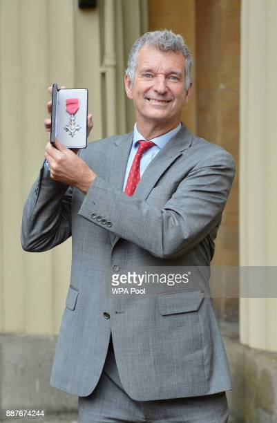 Tony Hawks poses with his Member of the British Empire medal that was presented to him by the Prince of Wales during an Investiture ceremony on...